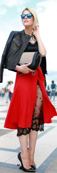 Leather biker jacket, chanel bag + slit wrap skirt w/scalloped hem under garment.