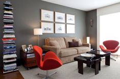 Gorgeous living room with Swan chairs in vivacious red 7 Cozy And Charismatic Mid Century Modern Chairs