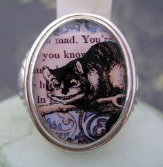 Cheshire Cat sterling silver ring from Tartx. I love the Cheshire Cat and am always on the look out for related pieces.