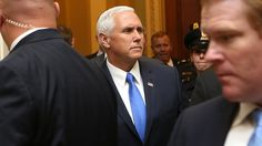 An Indianapolis sports columnist accused Vice President Mike Pence of using a Colts game to stage a political event after Pence walked out of the game over football players kneeling during the national anthem.