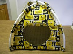 Georgia Tech Handmade Fabric Pup Tent Pet Bed. Avail @ http://stores.sharonsdecoratedbooks.com/ Beds r made when ordered and payment is received. The average time that it takes for the Bed to ship after payment is usually 5 biz days. The Pet Beds are made of licensed cotton NCAA College material, but are not licensed by the NCAA College. They are handcrafted and resold under rights granted by the 1st sale doctrine. We are not affiliated with The Licensed Company in any way. ***22$ Sm  27$ Lg