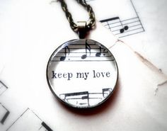 """""""Keep My Love"""" Sheet music necklace."""