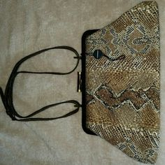 Burberry snakeskin print  cloth hand bag/clutch Burberry. VINTAGE! Cloth lining inside. Made in Italy.  Includes Original Burberry hang tag. Great condition!!! Last pic has authenticity signature.  Comes with an original adjustable thin strap. Snap closure Works well. Hang on the shoulder or around the arm or clutch.  Slip pocket inside. Bag can hold  Samsung S5 phone, ID, card, lipstick and carkeys. REALLY CUTE! !!!! No dustbag. Purchased a few years ago at Burberry store in SFO. Authentic…