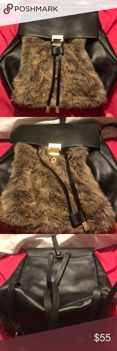 Faux fur & Leather Zara Backpack A beautiful brown faux fur backpack with snap button closure and dual pull string. Two leather adjustable belt straps. With a strap for hooks on the top. Beautiful black bag good for day work or night play. Zara Bags Backpacks