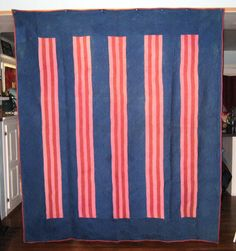 """Amish split bars quilt, $6,300. From Mifflin County, PA. It dates to the 1890s and is in excellent condition. Wool. 99"""" x 79""""."""