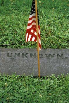 American flag by grave at Civil war cemetery, Gettysburg, Pennsylvania, USA