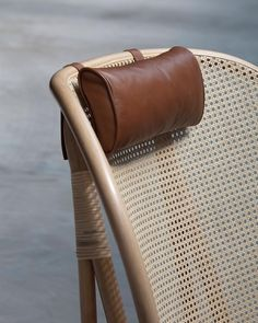 Rattan chair with leather headrest