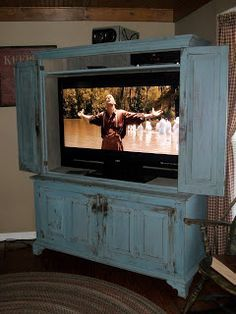 OK - put one of these on display in the living room for the beauty and for watching the news, etc. and then have a flat screen hidden for watching movies and series. Description from pinterest.com. I searched for this on bing.com/images