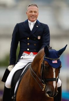 Jan Ebeling, of the United States, smiles after competing in the equestrian dressage competition with his horse Rafalca, co-owned by Ann Romney, the wife of U.S. Republican presidetial candidate Mitt Romney.
