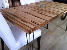 Modern industrial/mid century modern dining table featuring wormy maple top and hairpin legs.. $695.00, via Etsy.