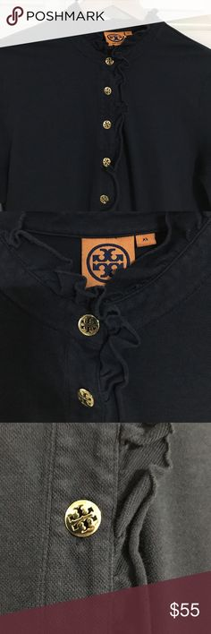 TORY BURCH Navy blue long sleeve polo shirt Tory Burch Long sleeve polo shirt with ruffles around neck and along the buttons. Button-down pullover, buttons go half way down. Size is XL but listing as a MEDIUM, as this fits a medium best. Has been worn and washed several times, but still in good condition. Navy blue some slight color fading from washing, but no pulls or snags. Good quality shirt. Tory Burch Tops Button Down Shirts