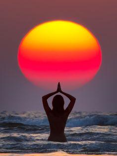 "500px / Photo ""SURYA NAMASKAR"" by Anton Jankovoy sunrise woman red sun silhouette india. yoga. meditate"
