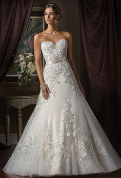 Jasmine Couture. The intricately embroidered lace of this wedding dress gives it unparalleled distinction and beauty.  Beautifully embroidered layers of Alencon Lace rest upon soft tulle.  With a strapless sweetheart neckline and a full A-line skirt, this dress is both stylish and extravagantly beautiful.