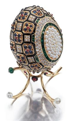 Gold, Diamond, Colored Stone and Cultured Pearl Egg Objet with Stand, Asprey. (Not jewellery as such, but exquisite)