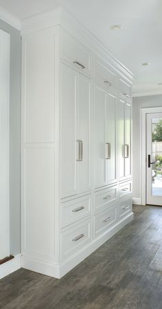 Custom Cabinetry - (armoire completely closed cabinet system)  Inspiration for a mudroom or any other space that needs organized storage custom designed to fit the client's needs.