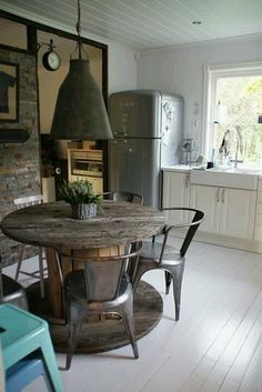 This vintage rustic kitchen is a looker: Recycled wood kitchen table and beautifully rusty Tolix chairs. Via Cristy Etchego.