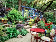 great leveled backyard... great use of color on the greenhouse.