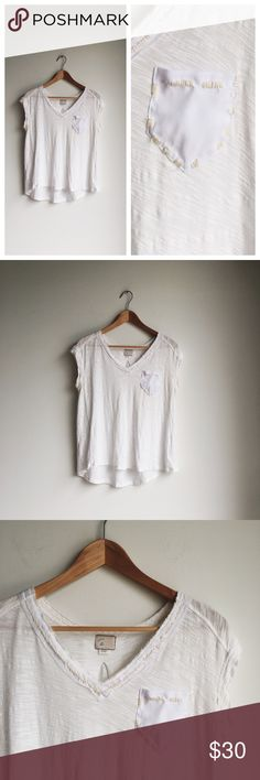Anthropologie White Cotton V Neck Tee Size Small Perfect staple piece! Great for layering with warmer pieces this fall. Like new! Features a raw v neck with thick ivory contrast stitching around neck and front pocket. Super soft! Anthropologie Tops Tees - Short Sleeve