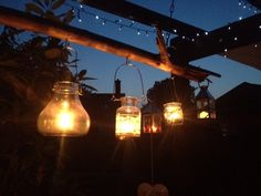 Fairy lights and jam jar lighting, perfect for a pergola