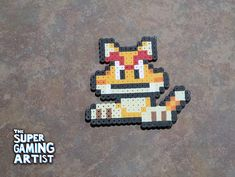 Check out this item in my Etsy shop https://www.etsy.com/listing/551151811/cat-goomba-super-mario-perler-super