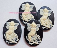 25x18 fairy on rock resin cameos ivory on black .. 4 pieces via Etsy