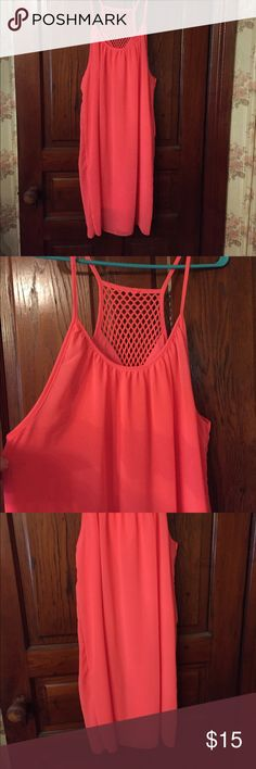 Strappy coral colored bathing suit cover up Super cute and lightly lined coral colored sundress/bathing suit cover-up. Has spaghetti straps and mesh back detail. I believe the size is an extra-large there is no tag. But it is brand-new never worn. Bundle and save! Dresses Midi