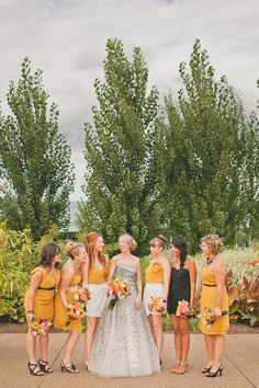 Picking a common color palette can make your bridesmaids look uniform, but still express their individuality. It's also a good way to set your maid of honor apart.    I don't know if the color is right, but I thought you might like to see it.