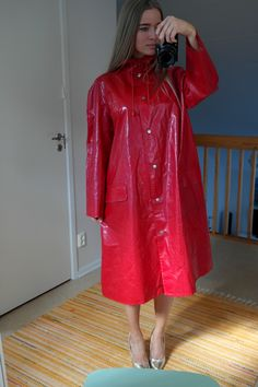 Rukka red raincoat.  I don't know who this lovely young woman is but I would like to and if she is not married if she would like to be