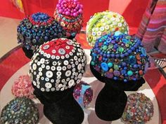 Kaffe Fassett Studio shows textile artist Kaffe Fassett's crocheted skull caps, which are embellished with buttons and beads. / AP