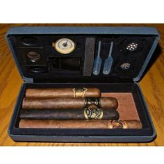 "Csonka Accessorized Traveler Portable Cigar Humidor Case by CSONKA WORLDWIDE. $59.99. Csonka Accessorized Traveler Portable Cigar Humidor Case. This travel case has a 4 cigar capacity (pending cigar size) and it is ultra compact and fully accessorized. Product Features: Complete built in humidification system designed for each style case Premium, unique grained handled stainless steel cigar cutter (3"" x 1"") Compact brass analog hygrometer (1"" x 1"") to keep you we..."