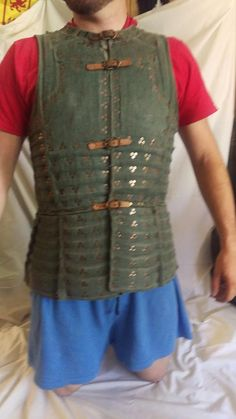 Used green Brigandine armor. Tinned plates affixed with triple rivet clusters. Shows some wear and has a small hole near a shoulder seam. Other than that it is fully serviceable. Hate to sell but need the funds for another project. This is the Sinric brig from the armor archive pattern section. Very comfortable armor. Would be great for light steel combat, SCA, reenactments,LARP, or other Not ACL,HMB combats.  Would fit a 5'10 to 6'3 frame at 190 lbs to 230lbs depend