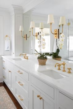 The backplate of the Hulton Sconce by Thomas O'Brien masters understated elegance with subtle stacking of metal and crystal, making it an iconic favorite ✨✨✨ Interior Design: @mollybasileinteriors 📸 : @margaret.wright #circalighting White Master Bathroom, Guest Bathrooms, Gold Bathroom, Classic Bathroom, Light Gray Cabinets, Houston Houses, Shower Floor Tile, Bathroom Inspiration, Bathroom Ideas