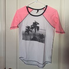 Graphic Tee PRICE IS NEGOTIABLE! black, white, and pink tee with a picture of palm trees. full tilt. worn a couple of times so in good condition! Tilly's Tops