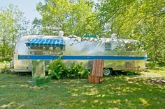 eclectic exterior by Louise Lakier Houzz Never would have thought of this... Vintage Airstream parked in yard as a guest house...hmmm...