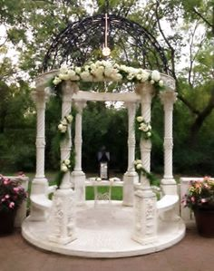 Wonderful White & Blush Gazebo Decoration for a Garden Wedding featuring hydrangea, blush & white spray roses and amazing white roses all intertwined in a garland of ferns and ruscus by Jenny Thomasson AIFD CFD of Stems Florist, St. Louis, MO  www.stems4weddings.com  #garlands #gazebo #arbor #wedding