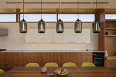 A Sonoma Valley home with boastful views and handmade modern pendant lights was designed with the intention to experience nature through architecture. Modern Pendant Light, Pendant Lighting, Kitchen Dining, Kitchen Cabinets, Sonoma Valley, Shared Rooms, Grey Glass, Dining Room Lighting, Floor Plans