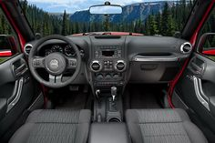 Inside the Jeep Wrangler... end of discussion. my new goal is this car.