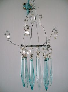 the fisherman's cottage: Handmade Chandelier My crystals are clear but I think I can do this if it is just wire, beads and crystals. Handmade Chandelier, Wire Chandelier, Chandelier Ideas, Chandelier Crystals, Fishermans Cottage, Art Fil, Arts And Crafts, Diy Crafts, Suncatchers