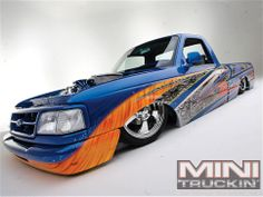 Blue & orange Gen-III lowered Ford Ranger at Mini Truckin.