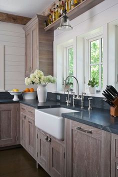 Chic country kitchen with wire brushed oak kitchen cabinets - love this look http://thegardeningcook.com/best-home-decor-ideas/