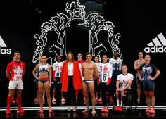 Team GB pose for a photo with designer Stella McCartney