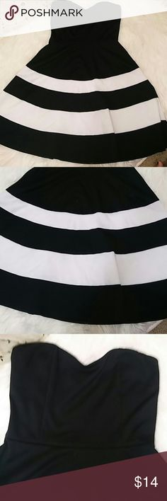 Black and white strapless Charlotte russe dress. Super complementing. Bottom has just the right volume while the top is fitted. Pretty black and white stripes. Nwot. Charlotte Russe Dresses Mini