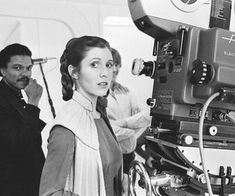 Image uploaded by Dani Lurie. Find images and videos about star wars, carrie fisher and Princess Leia on We Heart It - the app to get lost in what you love. Billy Dee Williams, Star Wars Watch, Miss Moss, The Empire Strikes Back, Carrie Fisher, People Around The World, On Set, Girl Photos, Cute Couples