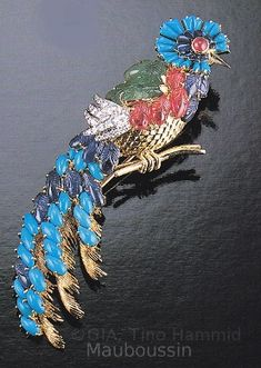 Bird Brooch, signed Mauboussin Paris 1968, turquoise, gold, sapphires, rubies, emeralds,and diamonds