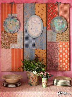 decoupage fabric onto panels and then add plates