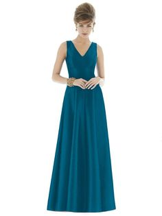 Peau de soie drapes the form-fitting princess silhouette of Dessy Alfred Sung D665 bridesmaid dress, enhanced with multiple seams running all the way down the richly flared floor-length skirt. The sleeveless bodice features a modest back to back V-neckline, projecting a demure appeal.