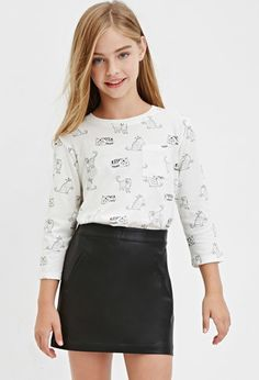 A knit top with an allover cat print, a chest patch pocket, and 3/4 sleeves.- $9.90