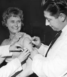 Smallpox vaccination - A woman receives her smallpox vaccination in 1962. A routine vaccination given to most everyone until 1972.