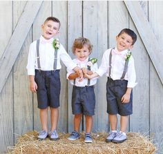 Handsome little men in navy shorts, suspenders, and a blush pink bow tie! Adorable for your ring bearer outfit! | Etsy: TheLittlestGentleman