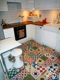 Kitchen floor Patchwork of  Andalusian Tiles suitable for both walls and floors. Encaustic excellence! Hand made and crafted in Spain.